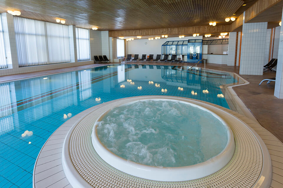 indoor swimming pool whirlpool hotel laaxerhof
